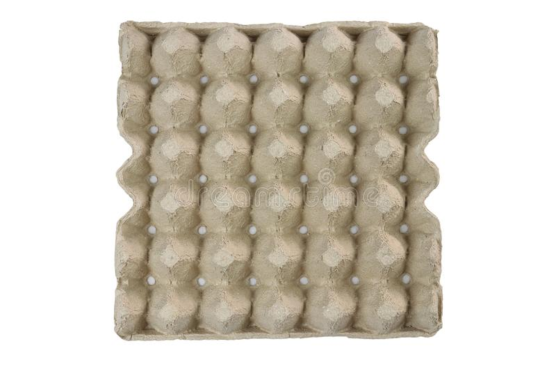 A bandeja do ovo, empilha o cartão que empacota para os ovos isolados no fundo preto imagem de stock