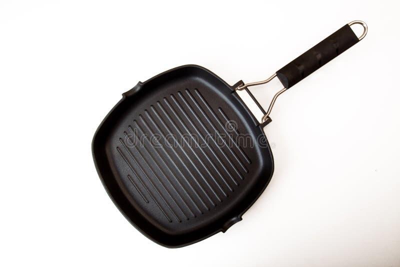 Bandeja vazia de fritura nova da grade isolada no fundo branco imagem de stock