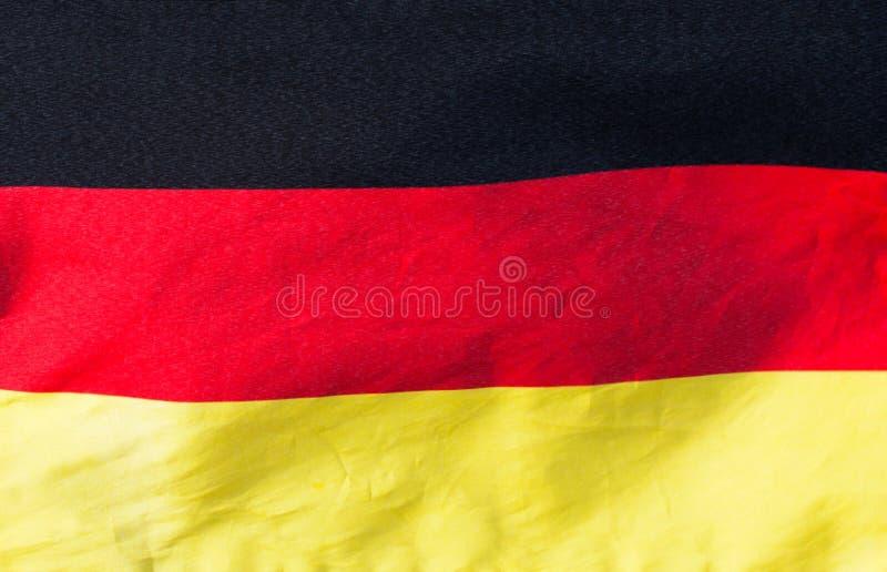 Bandera alemana en el primer del viento fotografía de archivo libre de regalías