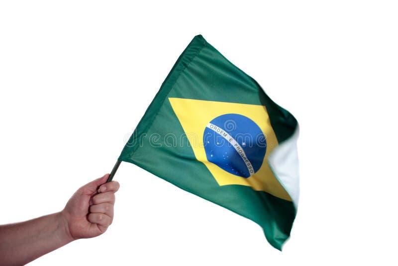 Bandera brasileña que agita foto de archivo