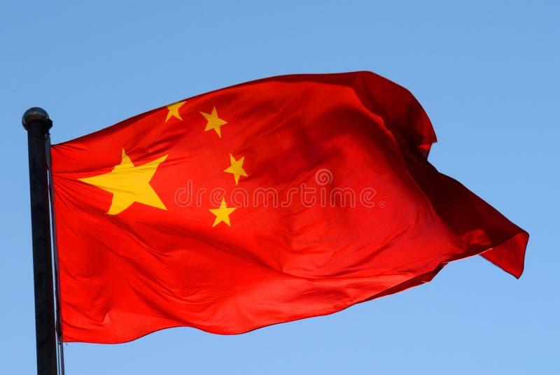 Bandera china en una luz del sol fotografía de archivo libre de regalías