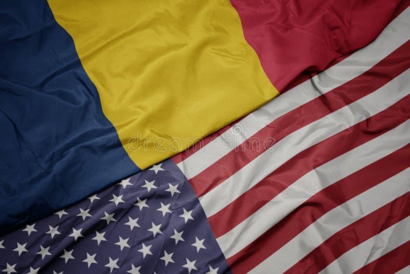 bandera colorida que agita de los Estados Unidos de América y bandera nacional del sábalo foto de archivo libre de regalías