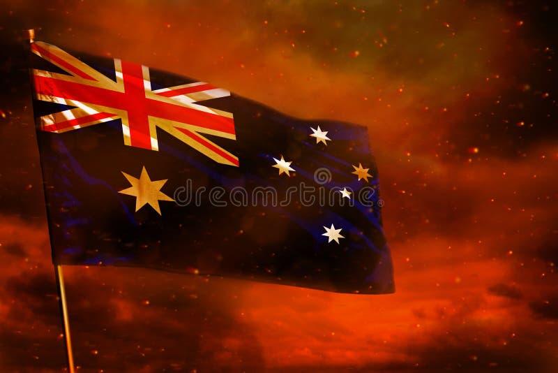 Bandera de Australia que agita en el cielo rojo carmesí con el fondo de los pilares del humo Preocupa concepto imagen de archivo libre de regalías