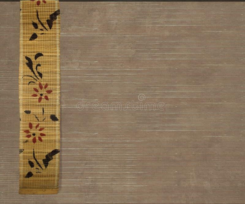Bandera de bambú de la flor en fondo marrón claro fotografía de archivo libre de regalías