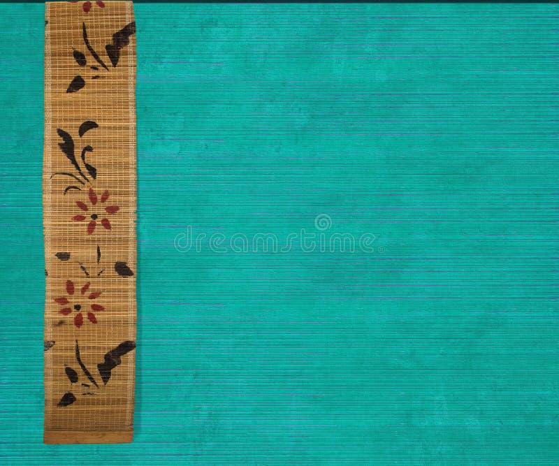 Bandera de bambú de la flor en la madera del aquamarine imágenes de archivo libres de regalías