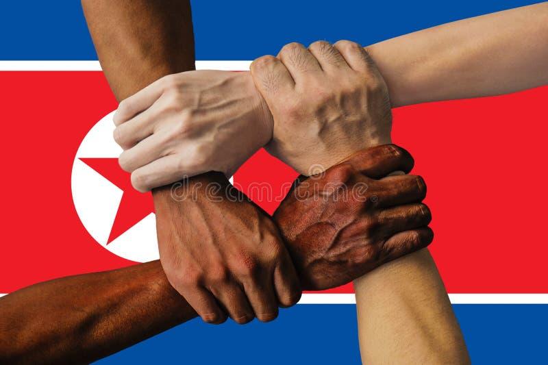 Bandera de Corea del Norte, integración de un grupo multicultural de gente joven fotos de archivo
