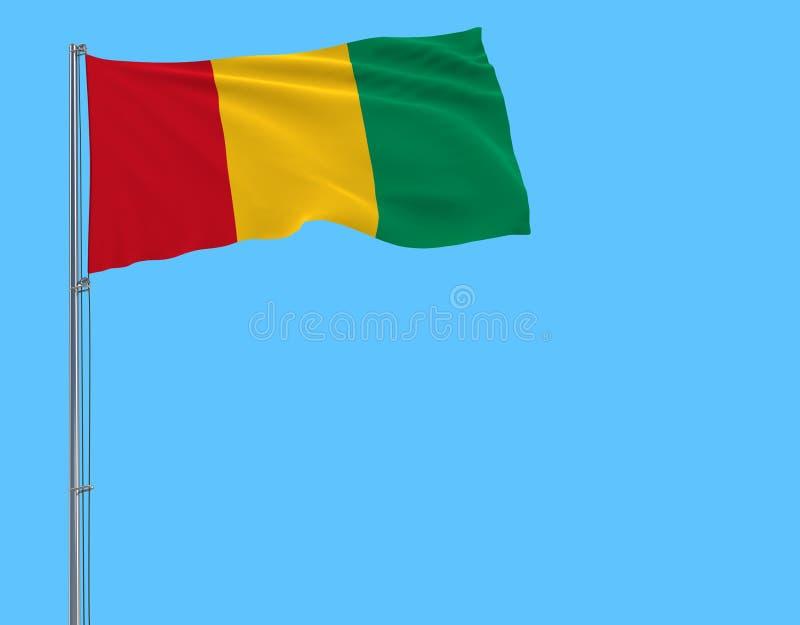 Bandera de Guinea en una asta de bandera que agita en el viento en un fondo azul, del aislante representación 3d libre illustration