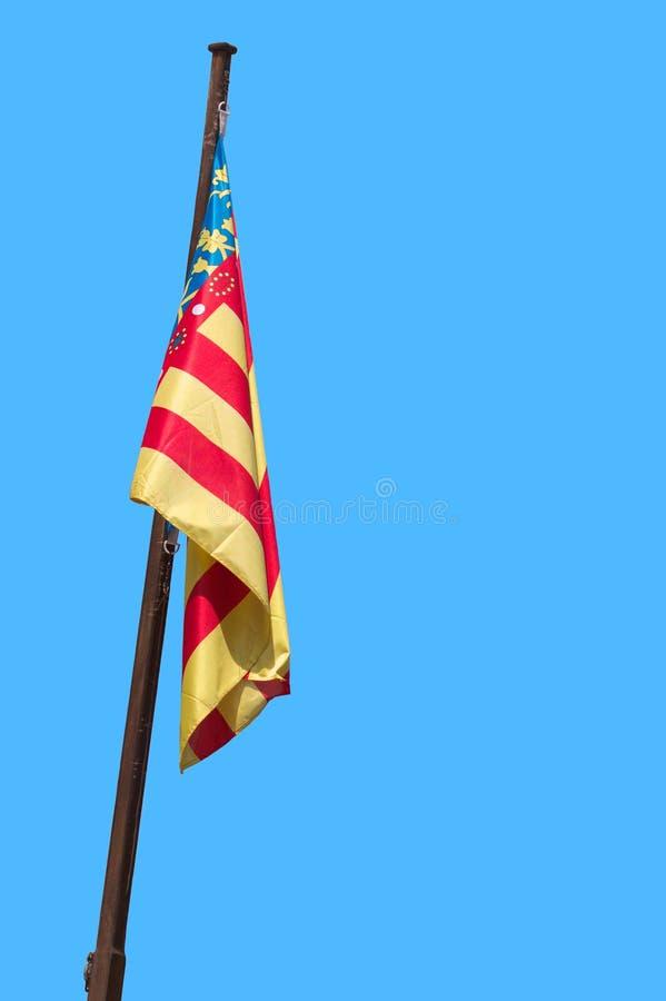 Bandera de la comunidad valenciana en un palo imagen de archivo