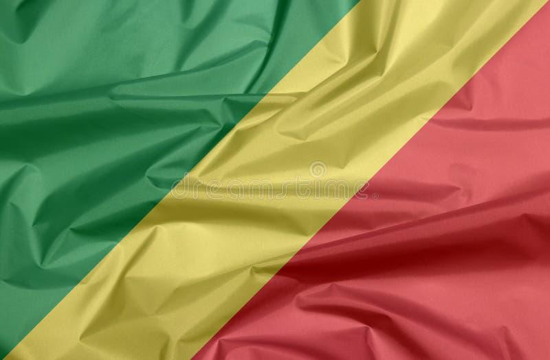 Bandera de la tela de Congo Pliegue del fondo congolés de la bandera imagen de archivo
