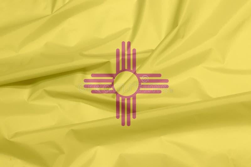 Bandera de la tela de New México Pliegue del fondo de la bandera de New México, los estados de América fotos de archivo