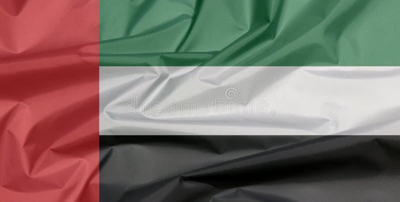 Bandera de la tela de United Arab Emirates Pliegue del fondo de la bandera de los UAE fotografía de archivo