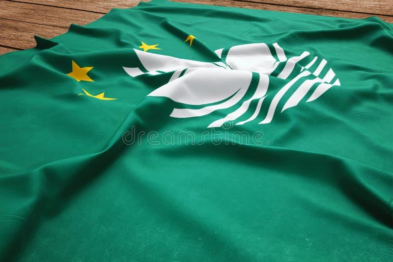 Bandera de Macao en un fondo de madera del escritorio Opini?n de top de seda de la bandera de Macao imágenes de archivo libres de regalías