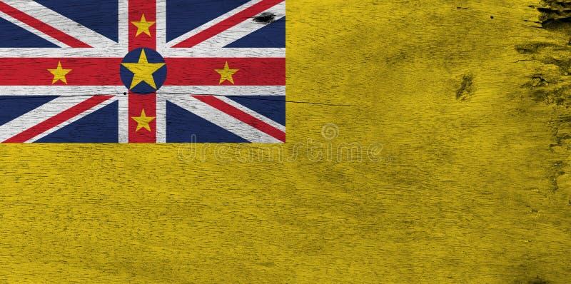 Bandera de Niue en fondo de madera de la placa Textura de la bandera de Niue del Grunge fotografía de archivo