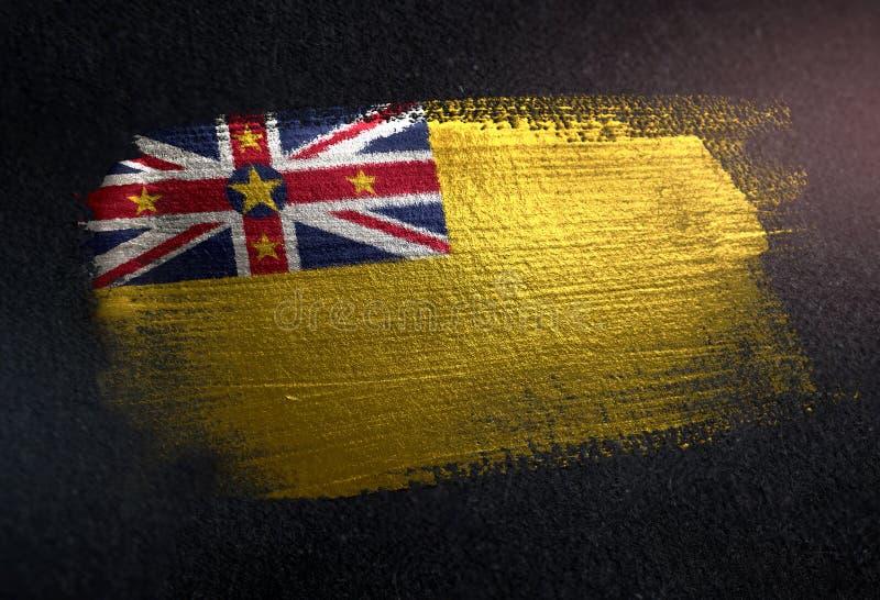 Bandera de Niue hecha de la pintura metálica del cepillo en la pared de la oscuridad del Grunge fotografía de archivo libre de regalías