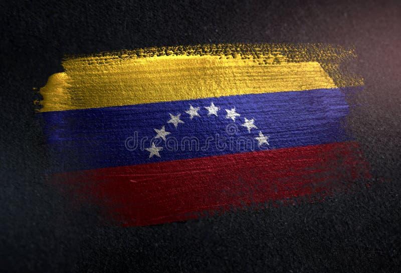 Bandera de Venezuela hecha de la pintura metálica del cepillo en la pared de la oscuridad del Grunge fotografía de archivo