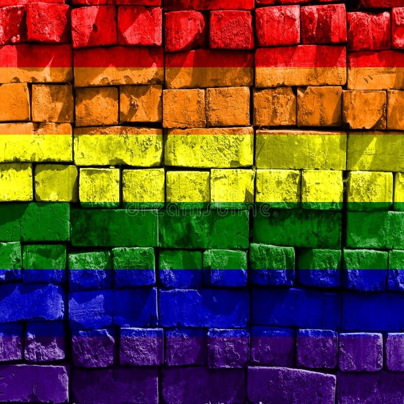 Bandera del arco iris de la pared de ladrillo fotos de archivo libres de regalías