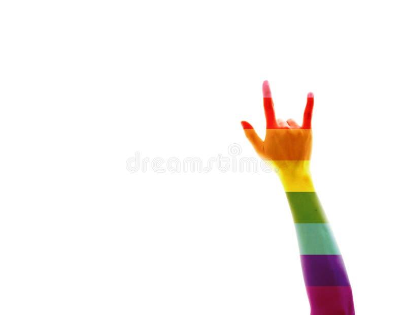 Bandera del arco iris, mano que muestra símbolo del corazón imágenes de archivo libres de regalías
