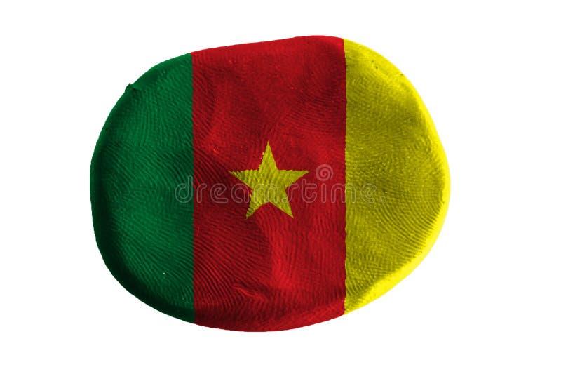 Bandera del Camerún, arcilla de la bandera en el fondo blanco imagen de archivo libre de regalías
