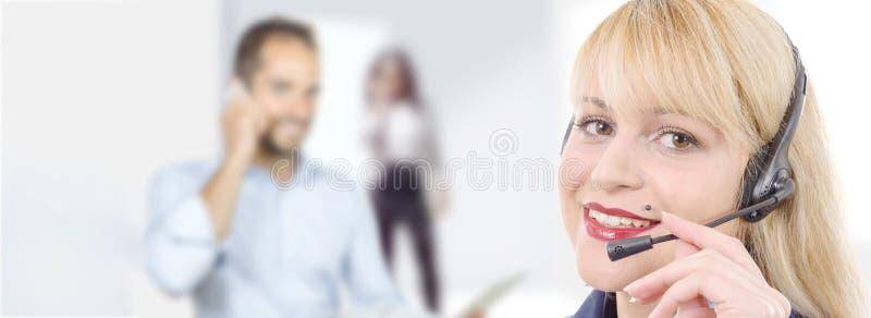 Bandera del operador alegre sonriente del teléfono de la ayuda en auriculares imagen de archivo libre de regalías