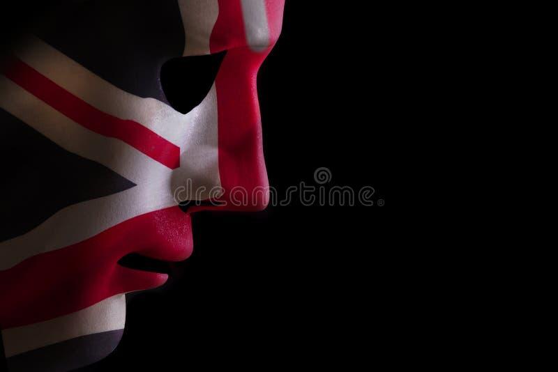 Bandera del Union Jack de la mascarilla en negro fotografía de archivo