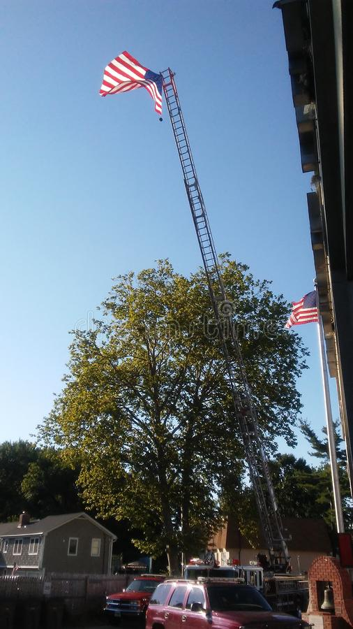 Bandera en el viento imagen de archivo