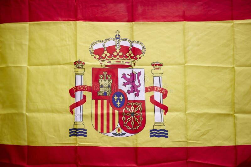 Bandera española con el escudo y la corona real Monarca constitucional foto de archivo libre de regalías