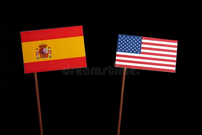 Bandera española con la bandera de los E.E.U.U. en negro foto de archivo libre de regalías