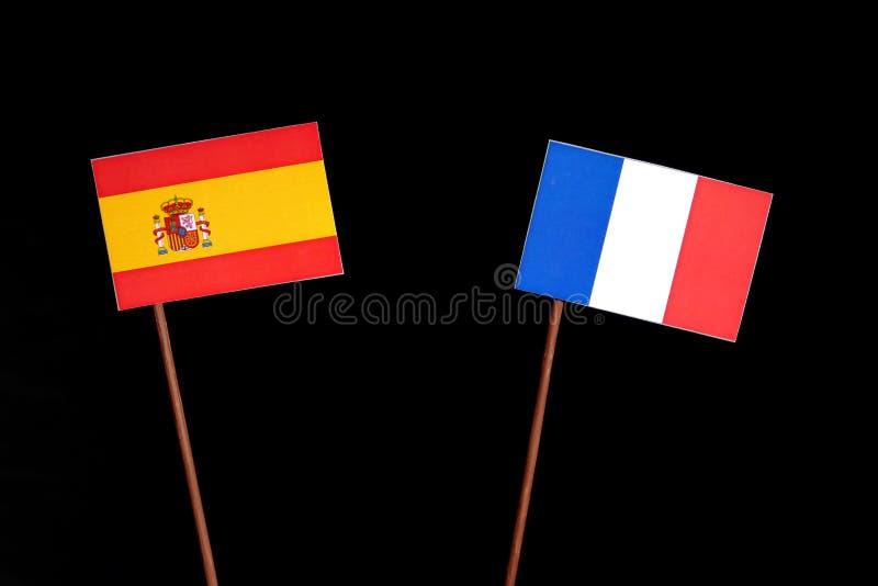Bandera española con la bandera francesa en negro fotografía de archivo