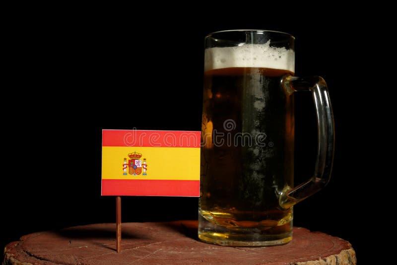 Bandera española con la taza de cerveza en negro foto de archivo libre de regalías