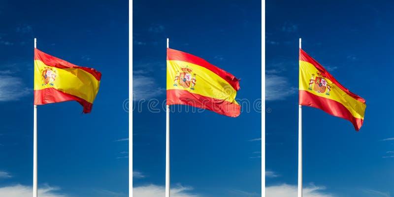 Bandera española el flamear encaramada encima de un temblequeo de la asta de bandera foto de archivo libre de regalías