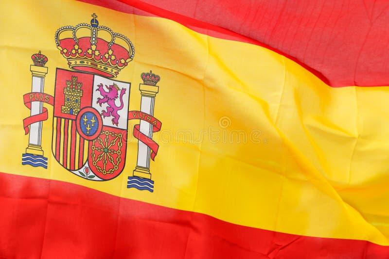 Bandera española en el viento en luz del sol imágenes de archivo libres de regalías