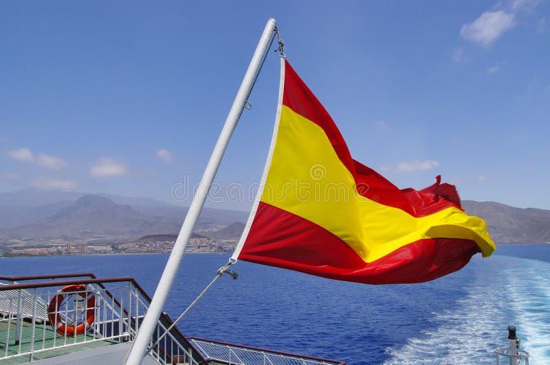 Bandera española en un palo fotos de archivo