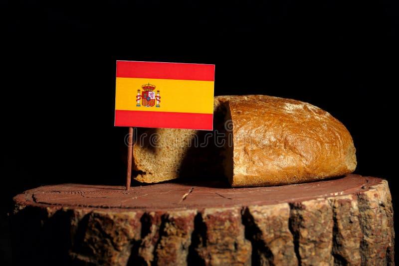 Bandera española en un tocón con pan fotos de archivo