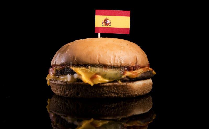 Bandera española encima de la hamburguesa en negro imagen de archivo