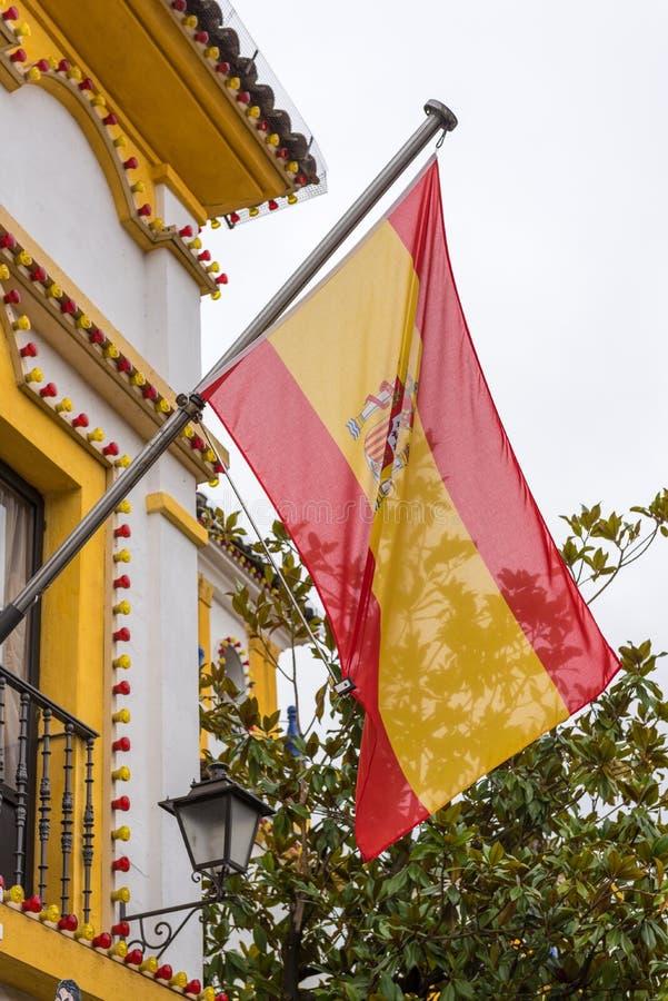 Bandera española llameante imagen de archivo