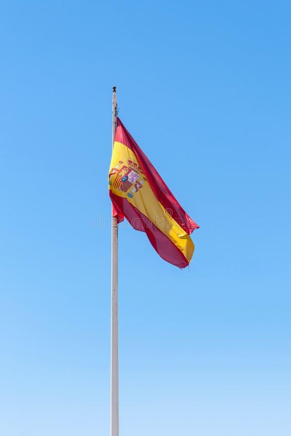 Bandera española que agita foto de archivo