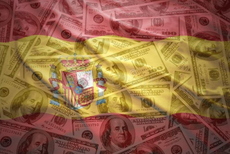 Bandera española que agita colorida en un fondo del dinero del dólar fotos de archivo libres de regalías
