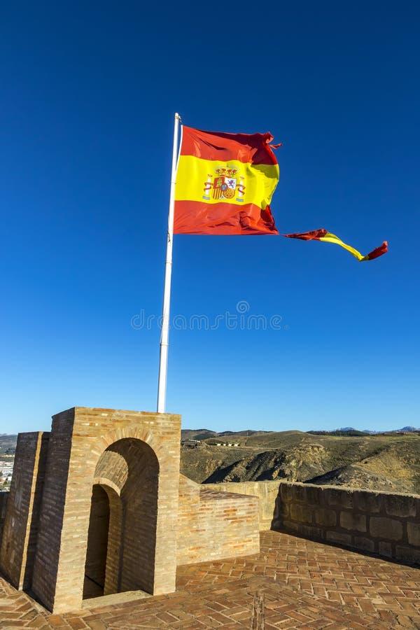 Bandera española rasgada que agita en el viento imagen de archivo libre de regalías