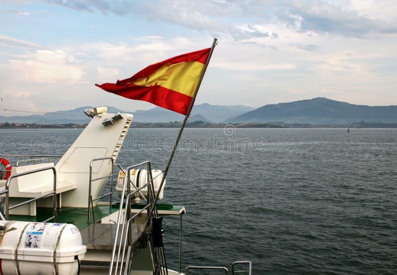 Bandera española sobre el mar fotografía de archivo libre de regalías