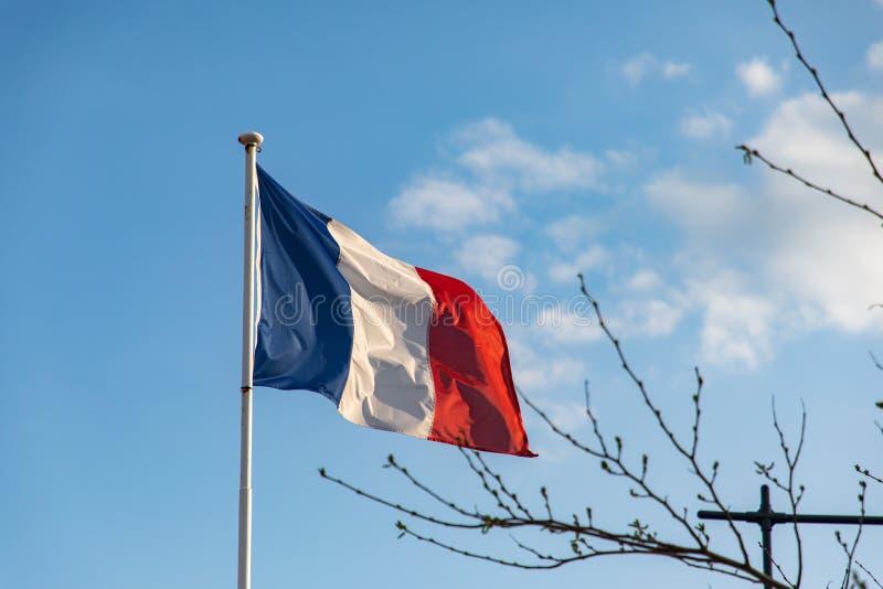 Bandera francesa que agita en el viento fotografía de archivo