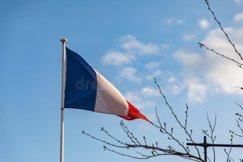 Bandera francesa que agita en el viento foto de archivo libre de regalías