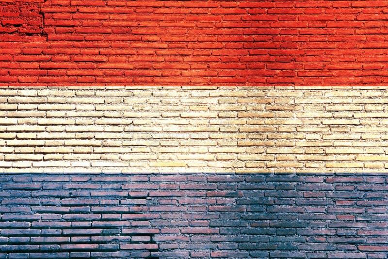 Bandera holandesa pintada en una pared de ladrillo ilustración 3D stock de ilustración