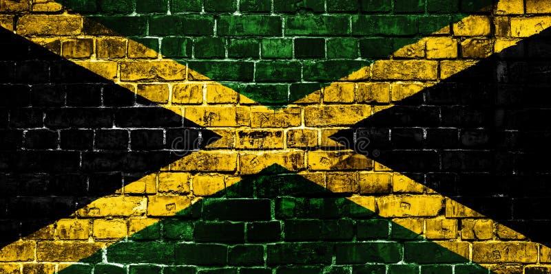Bandera nacional de Jamaica en un fondo del ladrillo imágenes de archivo libres de regalías