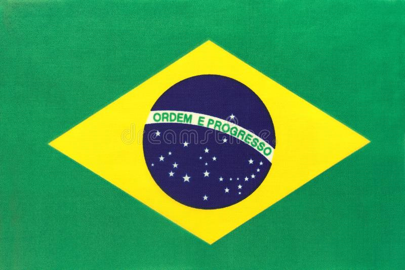 Bandera nacional de la tela del Brasil, fondo de la materia textil Símbolo del país internacional de América del mundo fotos de archivo