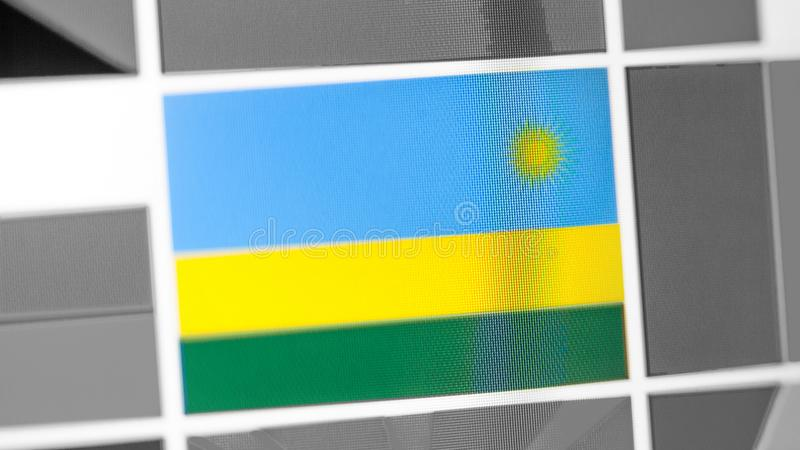 Bandera nacional de Rwanda del país Bandera de Rwanda en la exhibición, un efecto de moaré digital foto de archivo libre de regalías