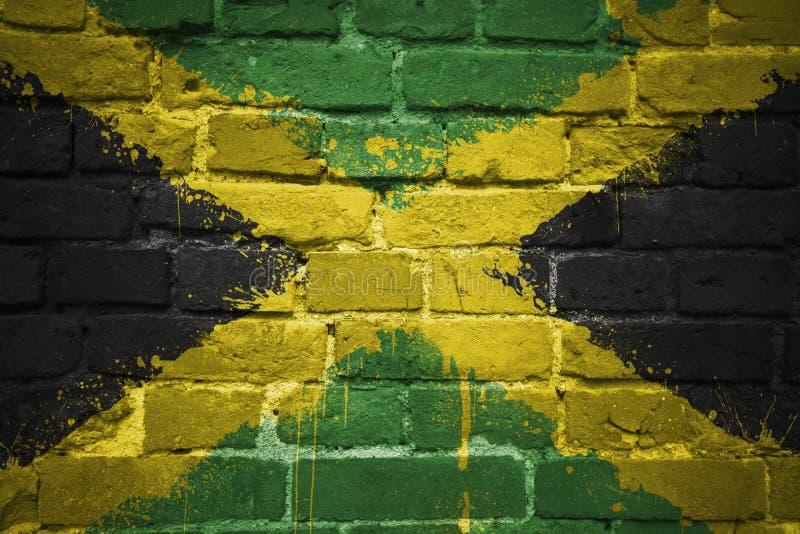 Bandera nacional pintada de Jamaica en una pared de ladrillo fotos de archivo libres de regalías