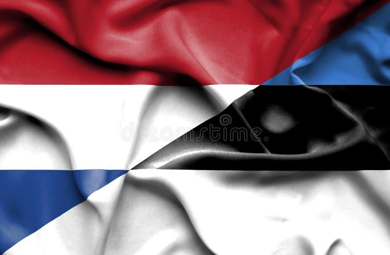 Bandera que agita de Estonia y de Países Bajos libre illustration