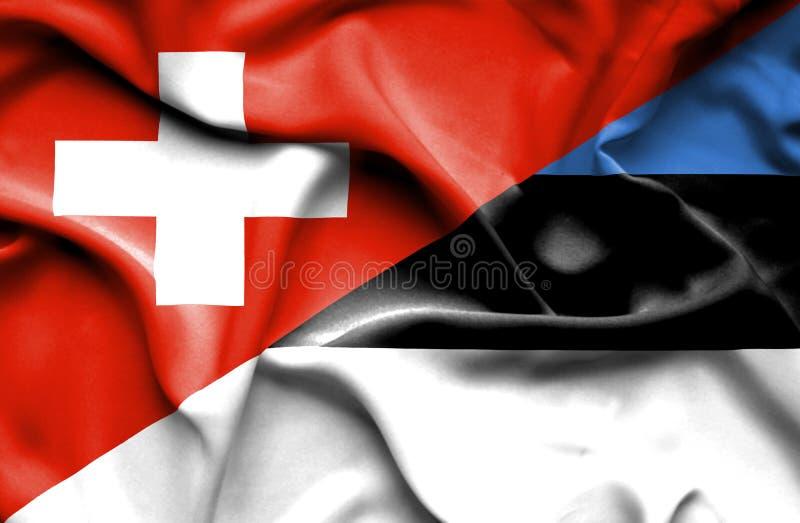 Bandera que agita de Estonia y de Suiza ilustración del vector