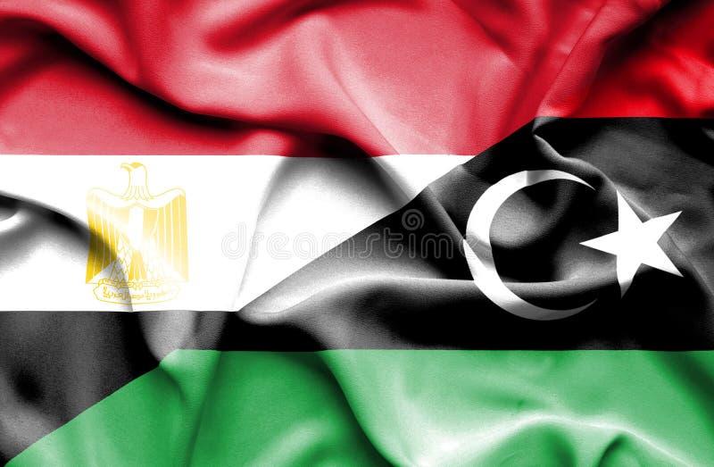Bandera que agita de Libia y de Egipto imagen de archivo