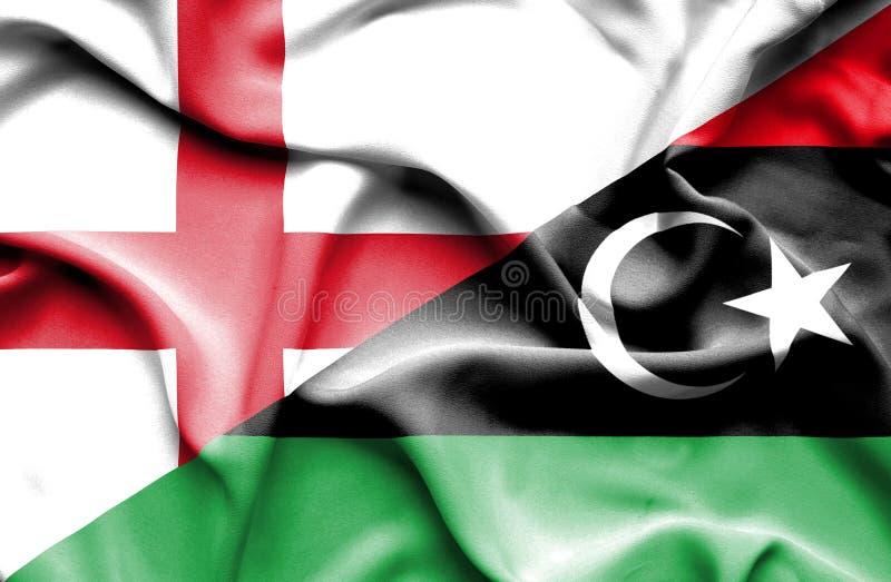 Bandera que agita de Libia y de Inglaterra imagen de archivo